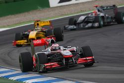 Jenson Button, McLaren Mercedes leads Robert Kubica, Renault F1 Team and Michael Schumacher, Mercedes GP