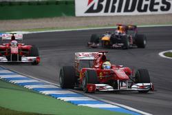 Felipe Massa, Scuderia Ferrari leads Fernando Alonso, Scuderia Ferrari and Sebastian Vettel, Red Bull Racing