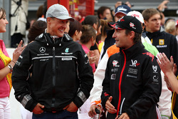 Michael Schumacher, Mercedes GP and Timo Glock, Virgin Racing
