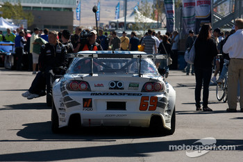 #69 SpeedSource Mazda RX-8 heads to the pre-race grid
