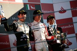 Esteban Gutierrez celebrates victory on the podium with Robert Wickens and Rio Haryanto