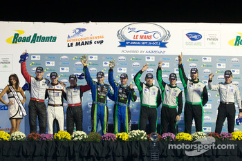 Championship podium: GT class champions Jörg Bergmeister, Patrick Long and Marc Lieb, P class winners David Brabham and Simon Pagenaud, GTC class winners Timothy Pappas, Jeroen Bleekemolen and Sebastiaan Bleekemolen, PC class winner Scott Tucker