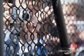 Fans take pictures of their favorite drivers