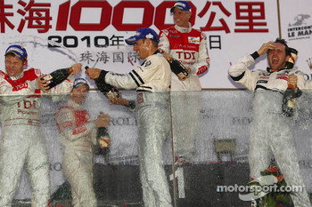 LMP1 podium: class and overall winners Stéphane Sarrazin and Franck Montagny celebrate with Tom Kristensen, Allan McNish and Rinaldo Capello