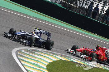 Nico Hulkenberg, Williams F1 Team leads Fernando Alonso, Scuderia Ferrari