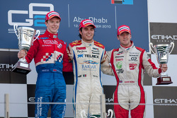 Sergio Perez celebrates his victory on the podium with Oliver Turvey and Sam Bird
