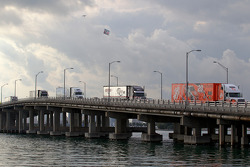 NASCAR haulers enter Miami Beach on MacArthur Causeway