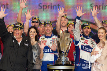 Championship victory lane: NASCAR Sprint Cup Series 2010 champion Jimmie Johnson, Hendrick Motorsports Chevrolet celebrates with Rick Hendrick, Chad Knaus, wife Chandra and daughter Genevieve Marie