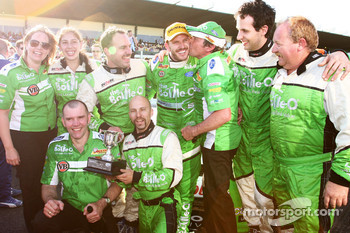 Paul Dumbrell celebrates with his team after taking his first career victory