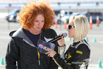 Miss Sprint Cup Amanda Wright interviews comedian Carrot Top during Wednesday's celebrity go-kart race