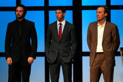 Jimmie Johnson, Denny Hamlin and Kevin Harvick stand on stage during the NMPA Myers Brothers Awards Luncheon at the Bellagio