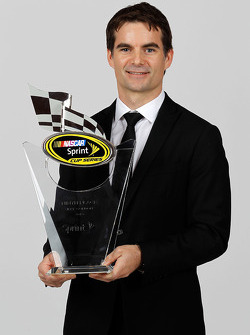 NASCAR driver Jeff Gordon poses with his ninth place trophy