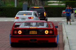 A Ferrari F40 finally makes it off the lawn and on to the street