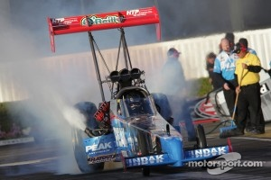 T. J.. Zizzo doing a burnout in his Peak Performance Top Fuel Dragster
