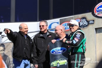 Ford racing executives along with John Force promoting Ford Focus giveaway