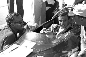 Jim Clark with Lotus designer Colin Chapman (in sunglasses)
