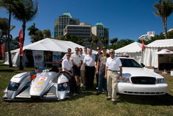 Go Green Auto Rally event in Miami: Gunnar Jeannette and Allan McNish pose with Tim Mayer and guests