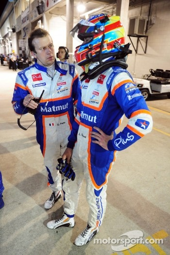 Olivier Panis talks to Loic Duval before the last stop