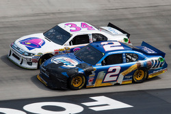 Brad Keselowski, Penske Racing Dodge and Travis Kvapil, Front Row Motorsports Ford