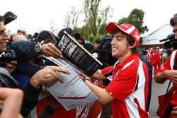 Fernando Alonso, Scuderia Ferrari signs an autograph