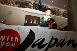 Takuma Sato, KV Racing Technology-Lotus with the banner to support Japan