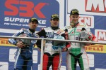 Marco Melandri, Carlos Checa, Leon Camier on the podium