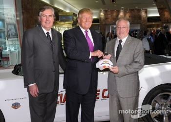 Donald Trump (C) accepts the keys to the Indianapolis 500 Chevrolet Camaro SS Convertible Pace Car from Jeff Belskus, CEO, Indianapolis Motor Speedway (L) and Jeff Chew, Marketing Manager, Chevy Racing (R), for the 100th Anniversary of the Indianapolis 50
