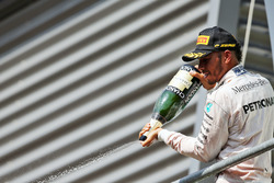Podium: Lewis Hamilton, Mercedes AMG F1 celebrates his third position with the champagne on the podium