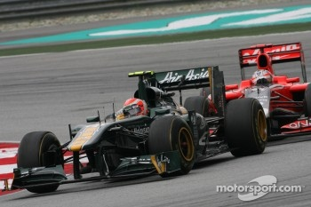 Jarno Trulli, Team Lotus and Timo Glock, Virgin Racing