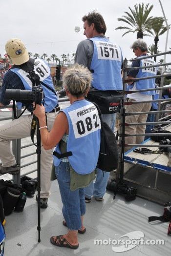 Baseball superstar turned photographer Randy Johnson shoots the opening laps in the photo tower atop turn 1