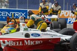 The safety crew works to get Ricardo Sperafio started