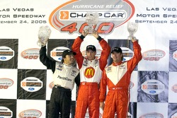 Podium: race winner Sébastien Bourdais with Oriol Servia and Jimmy Vasser