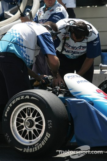 Mechanics work on Paul Tracy's car