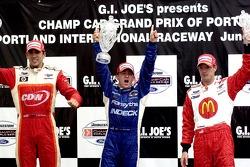 Victory podium: Justin Wilson, A.J. Allmendinger and Sébastien Bourdais