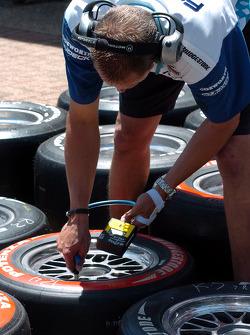 Forsythe Racing crew member prepares tires
