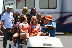 A golf cart full of Champ Car girls
