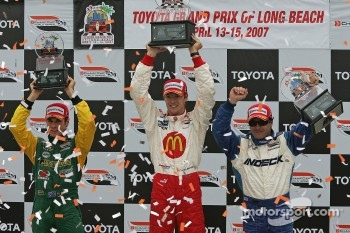 Podium: race winner Sbastien Bourdais celebrates with Oriol Servia and Will Power