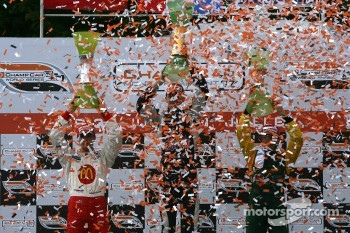 Podium: race winner Robert Doornbos celebrates with Sébastien Bourdais and Will Power