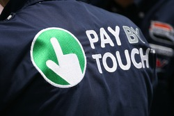 Pay by Touch logo on a crew member shirt