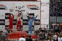 Podium: race winner Sébastien Bourdais with Bruno Junqueira and Graham Rahal