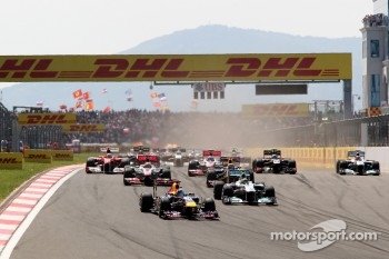 Sebastian Vettel, Red Bull Racing, RB7 leads Nico Rosberg, Mercedes GP F1 Team, MGP W02
