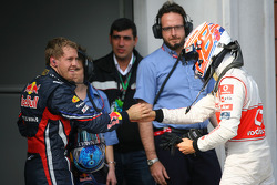 Race winner Sebastian Vettel, Red Bull Racing with Jenson Button, McLaren Mercedes