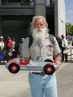 A fan shows off his vintage race car model