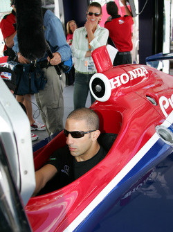 Tony Kanaan plays a racing simulator