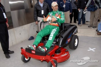 Pole winner Tony Kanaan enjoys his brand new Toro lawnmower