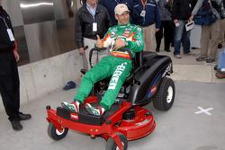 Pole winner Tony Kanaan enjoys his brand new Toro lawnmower