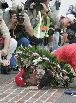 Race winner Dan Wheldon kisses the brickyard