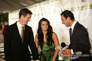 Helio Castroneves interviewing Danica Patrick and Paul Hospenthal in October 2005