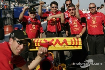 Andretti Green Racing team members celebrate pole position