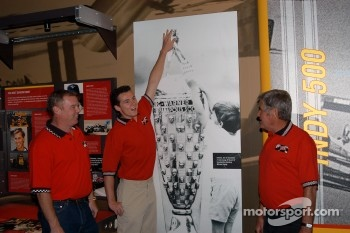 Al Unser, Jr., Al Unser III (recreating a famous post-race moment from the 1994 Indy 500) and Al Unser, Sr.